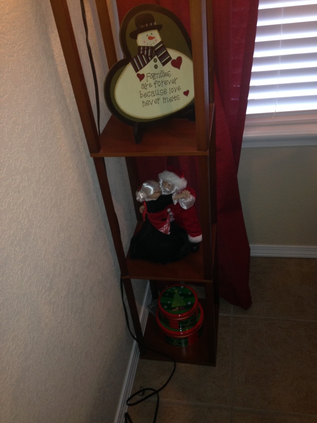Floor lamp shelf in my kitchen. More tins from Mimi and that Santa/Mrs. Claus dancing Figurine plays music and moves!