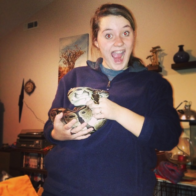 This is my cute, spunky, hilarious sister, Sierra. Holding a Ball Python. On my watch. Form a line for babysitting requests.
